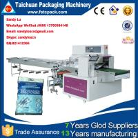 China Automatic gloves packaging machine , gloves wrapping machine on sale