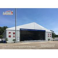 China 25m Width Aluminum Frame Waterproof And Flame Retardant Cover Hangar Tent With Auto Roll Up Door on sale