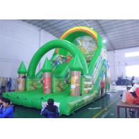 China Green Amusement Park Commercial Grade Inflatable Water Slide Custom Logo on sale