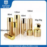 Cheap Golden Metal Spray Glass Cosmetic Packaging With Lotion Cap For Skin Care wholesale