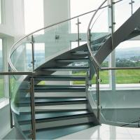 Cheap Wood Step Glass Rails Curved Staircase with Stainless Steel Stringer and Glass Railing for sale