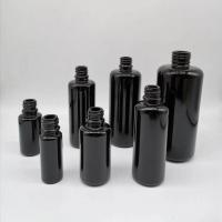 Best 10ml 15ml 30ml 50ml 100ml 200ml Black round shoulder essential oil empty cosmetic glass bottles with bamboo dropper wholesale
