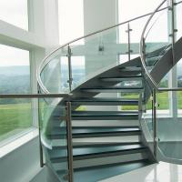 Best Stainless Steel Curved Stair with Wood Tread and Glass Railing Indoor Staircase wholesale