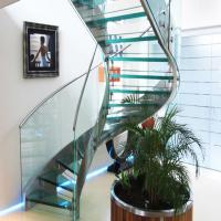 Cheap Prefabricated Stainless Steel Glass Stairs Curved Stair Manufacturers with Spigot Glass Railing for sale