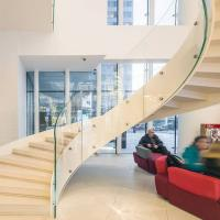 Cheap European-Style Stainless Steel Glass Curved Staircase Arc Stairs for sale