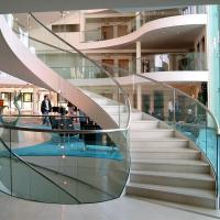Best Wood Step Glass Rails Curved Staircase with Stainless Steel Stringer and Glass Railing wholesale