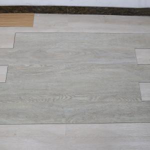 Cheap non deformation wood grain uv coating embossed PVC vinyl flooring planks for sale