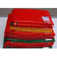 China Orange Color 25kg Mesh Packing Bags , PP Woven Mesh Vegetable Bags For Onions on sale