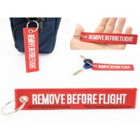 China Custom Embroidery Logo Remove Before Flight Keychain, Woven Logo Keychain, Red Remove Before Flight Keychain with Ring on sale