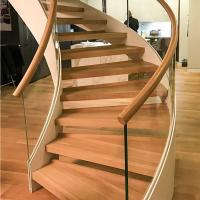 Best New Style Curved Staircase Solid Wood Treads and Tempered Glass Railings wholesale