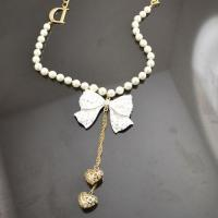 China Pearl bow gold heart pendant necklace on sale